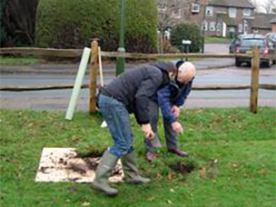 cllr alan head and tim laker planting the tree